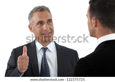 Thumbs up from a businessman - stock photo