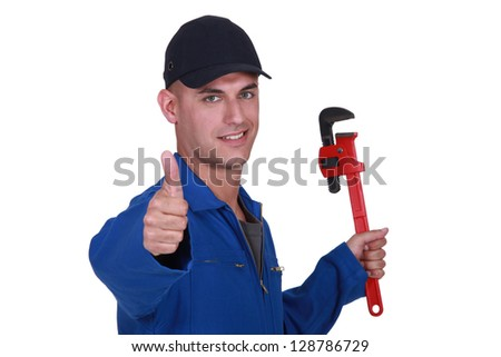 Thumbs up from a man with a wrench - stock photo