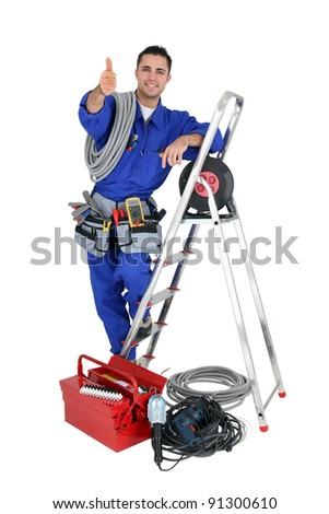 Thumbs up from an electrician - stock photo