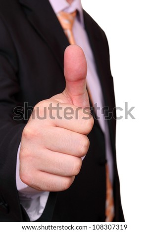 thumbs up from businessman - stock photo