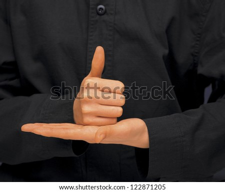 Thumbs up gesture on the palm of another hand