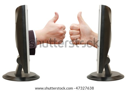 Thumbs up hand from the monitor - stock photo