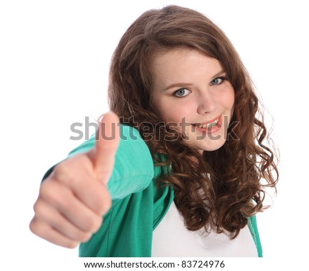 Thumbs up hand sign for success by happy pretty teenager school girl with long brown hair. Girl has blue eyes and a big beautiful smile.