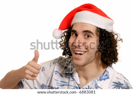 thumbs up! - happy young man in santa hat - isolated on white - stock photo