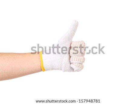 Thumbs up in a thin work glove with red pimple.