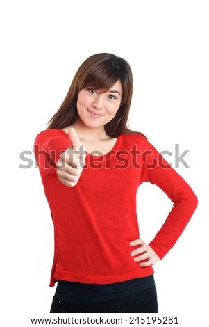 Thumbs up mixed race girl in red on white background - stock photo