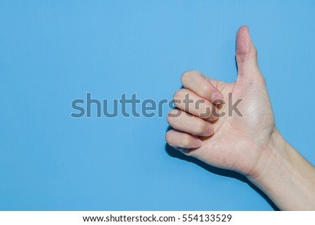 Thumbs Up on a blue background