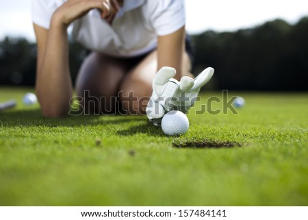 Thumbs up on golf  - stock photo