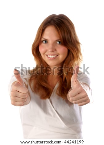 Thumbs up. Pretty young woman on white background (focus on hands) - stock photo