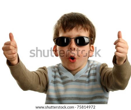 Thumbs up shown by a happy young boy on glasses, isolated on white - stock photo