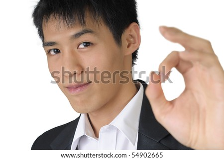 Thumbs up sign by handsome business man isolated against white. - stock photo