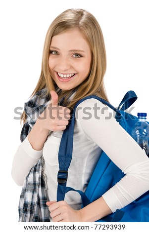 Thumbs up student teenager woman with shoolbag on white - stock photo
