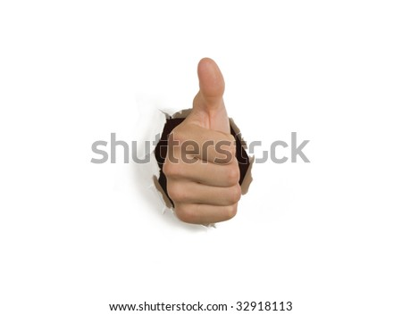 Thumbs up success hand breaking through white wall - stock photo