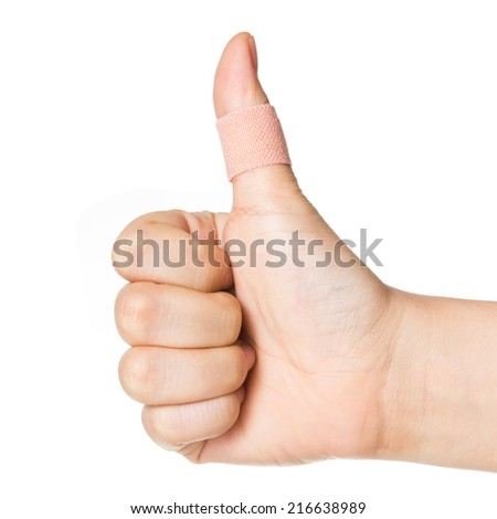 thumbs up with plaster bandage isolated on white background. - stock photo