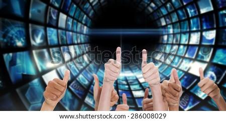 Thumbsup against vortex of digital screens in blue - stock photo