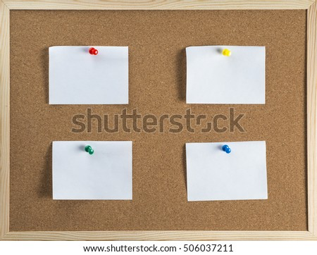 Thumbtack and note on corkboard