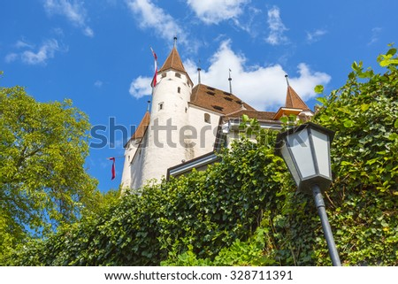 THUN, SWITZERLAND - SEPTEMBER 08, 2015: The Castle towering over the Castle Hill. The castle was built in the 12th century, nowadays it houses the Thun Castle museum - stock photo