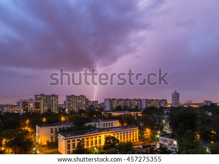 Thunder and Lightning over the city in the twilight sky