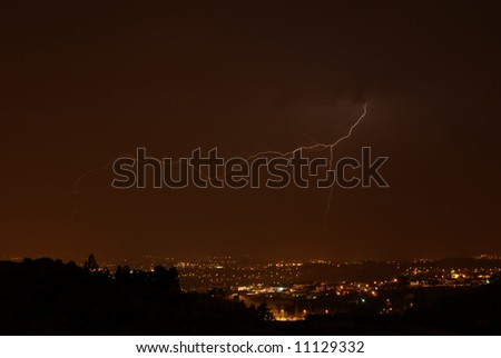 thunder at night over a city in portugal