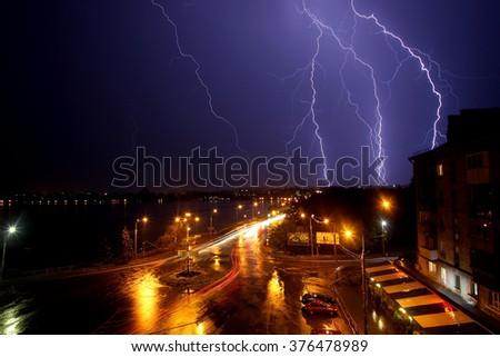 thunder, lightning over the city. dramatic evening sky - stock photo