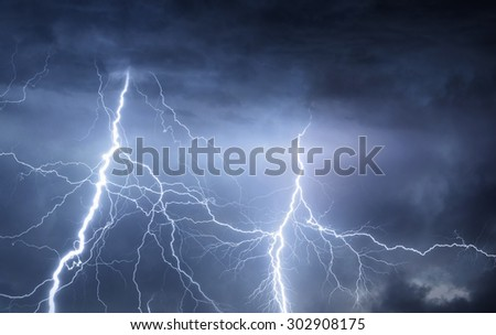 Thunder, lightnings and rain on stormy summer night. - stock photo