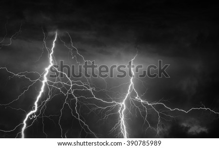 Thunder, lightnings and rain on stormy summer night in black and white.
