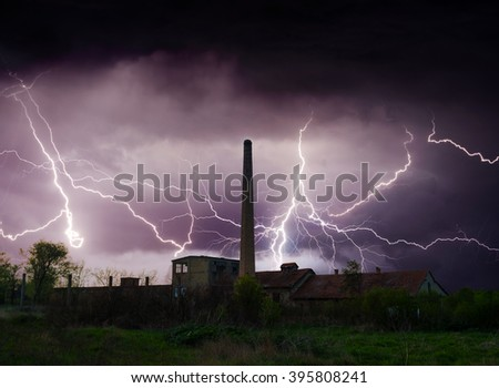 Thunder, lightnings and storm over abandoned factory in summer. - stock photo