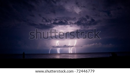 Thunder-storm and lightning in the sea - stock photo
