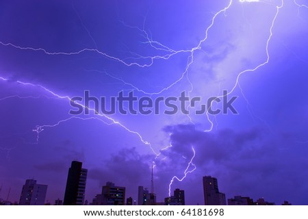 Thunder storm and power Lightning over city .
