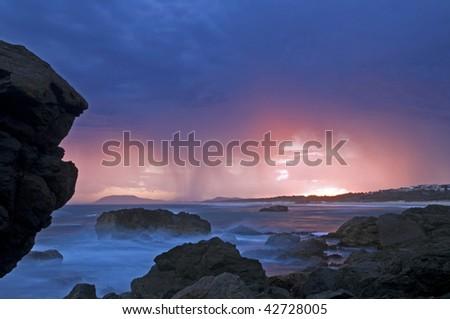 Thunder storm in the horizon at sunset - stock photo
