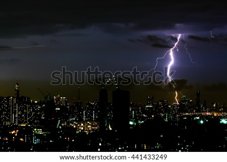 Thunder storm lighting bolt on the horizontal sky and city scape - stock photo