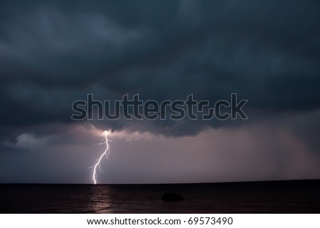 Thunder storm over the sea - stock photo