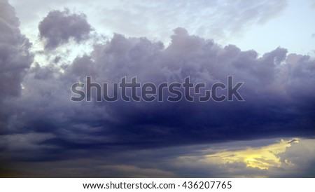 thundercloud purple in the sky before rain and storm - stock photo