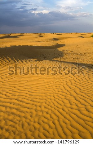 thunderclouds in the evening to deserts - stock photo