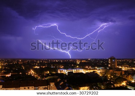 Thundershower and lightning over city of Pancevo Serbia - stock photo