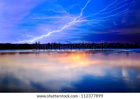 Thunderstorm above a lake - stock photo