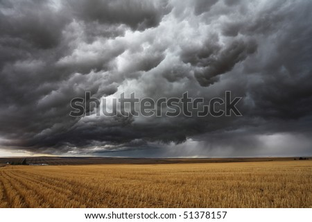 Thunderstorm above fields after harvesting. Montana, the USA - stock photo