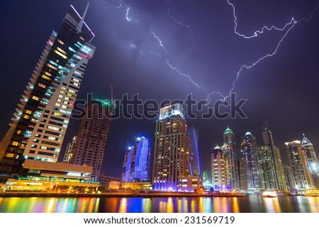 Thunderstorm in Dubai Marina at night, UAE - stock photo