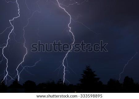 Thunderstorm in Germany after a hot day in July. - stock photo