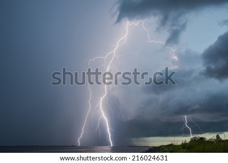 Thunderstorm lightnings in sky, lightning strikes. - stock photo