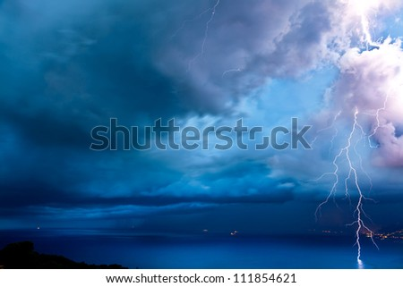 Thunderstorm over the sea - stock photo