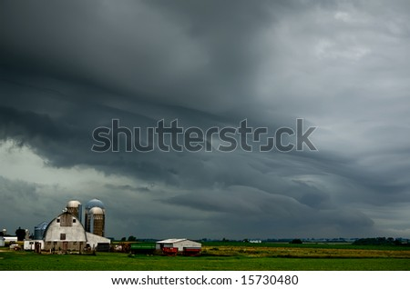 Thunderstorm rolling over a rural midwest farm area.