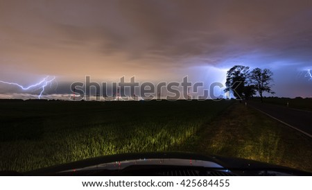 Thunderstorm with lightning and lightning strikes - stock photo