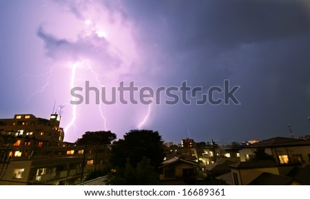 Thunderstorm with lightning in the city - stock photo