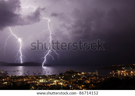 Thunderstorm with lightning over the city of Bodrum in Turkey - stock photo