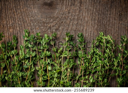 thyme herb on an old wooden board. - stock photo