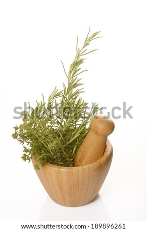 Thyme, rosemary and big salt in a mortar on white background