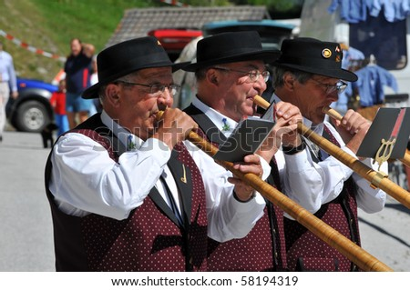 THYON, SWITZERLAND - JULY 31: Alpine horn blowers at the Swiss National holiday celebrations 2010 :  July 31, 2010 in Thyon, Switzerland
