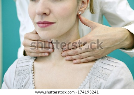 Thyroid Palpation, Woman - stock photo