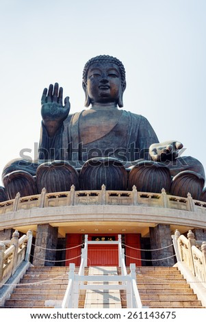 Tian Tan Buddha (the Big Buddha) is a large bronze statue of a Buddha Amoghasiddhi in Hong Kong. Hong Kong is popular tourist destination of Asia. - stock photo